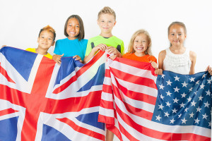 Funny kids holding flag Great Britain and american national flag